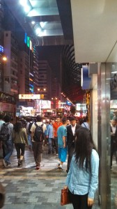 Random snapshot of foot traffic alongside Nathan Road in Hong Kong. This was around 8:00 PM on a Saturday evening.